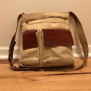 Well loved Leather and Canvas Fossil Purse